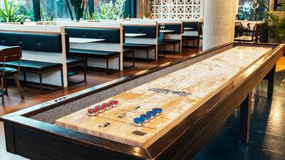 Fugitive Motel, Shuffleboard Table